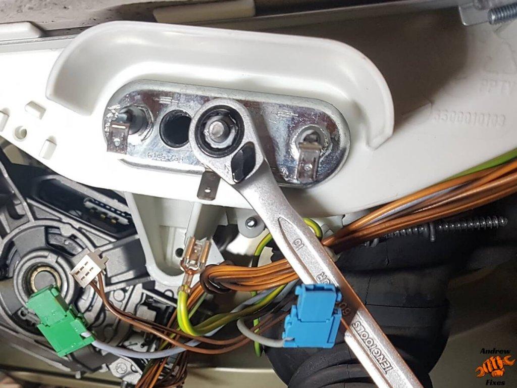Picture showing undoing Bosch washing machine heating element nut