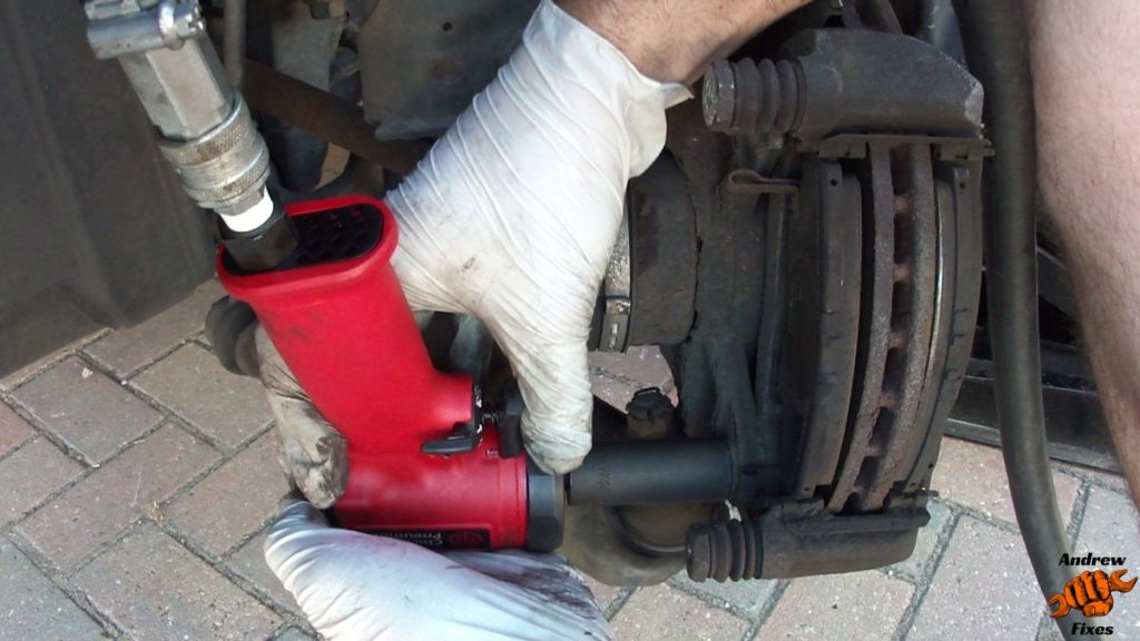 Picture of Chicago Pneumatic 3/8 compact impact wrench undoing brake pad carrier bolts