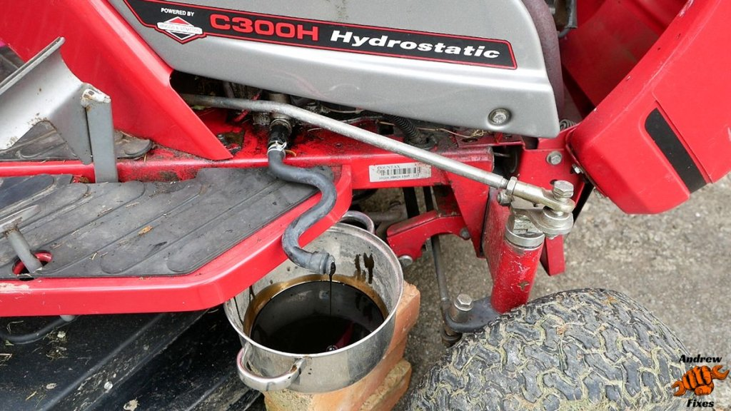 Picture showing oil draining from the Countax C300 engine