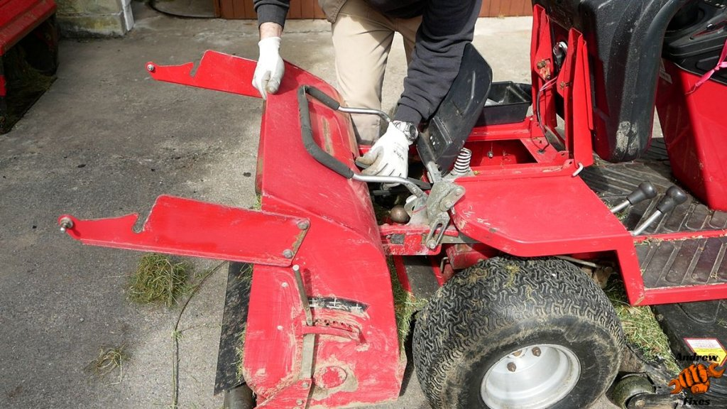 Picture showing removal of powered grass collector from Countax C300H